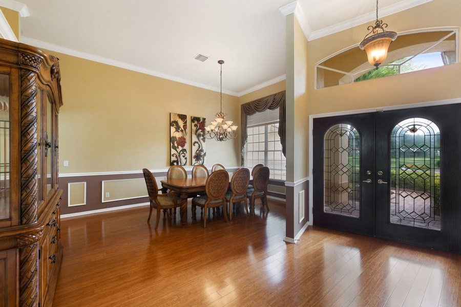 Real Estate Photography - 7957 Gator Palm Dr, Fort Myers, FL, 33966 - Foyer/Dining Room