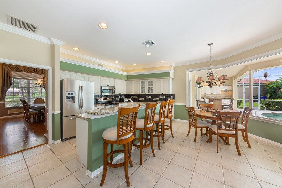 Real Estate Photography - 7957 Gator Palm Dr, Fort Myers, FL, 33966 - Kitchen / Breakfast Room