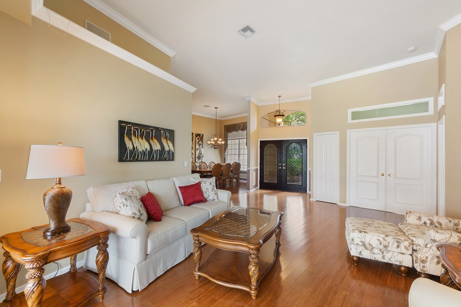 Real Estate Photography - 7957 Gator Palm Dr, Fort Myers, FL, 33966 - Living Room / Dining Room