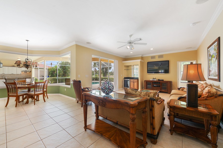 Real Estate Photography - 7957 Gator Palm Dr, Fort Myers, FL, 33966 - Family Room / Kitchen