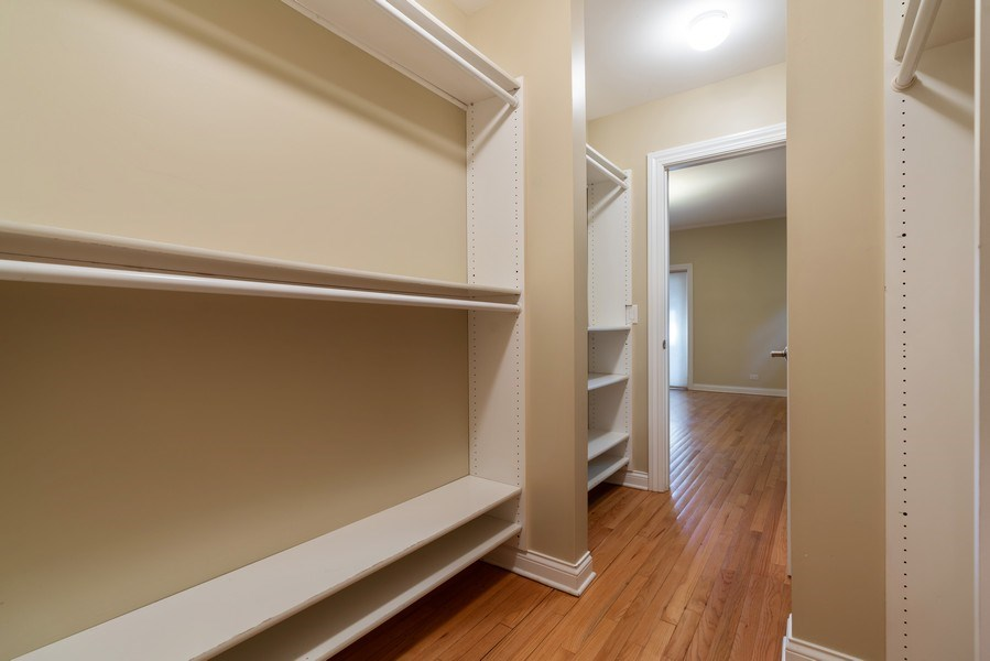 Real Estate Photography - 5482 S Woodlawn Ave, Chicago, IL, 60615 - Master Bedroom Closet
