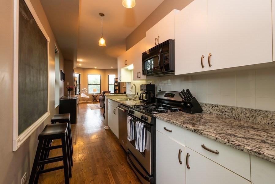Real Estate Photography - 1712 W Wilson Ave, Unit 3E, Chicago, IL, 60640 - Kitchen