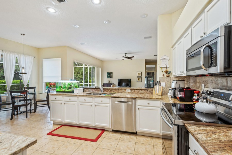 Real Estate Photography - 10417 Greenhedges Dr, Tampa, FL, 33626 - Kitchen