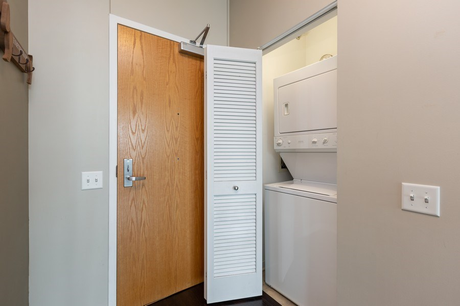 Real Estate Photography - 757 N Orleans, Unit 1303, Chicago, IL, 60654 - Laundry Room