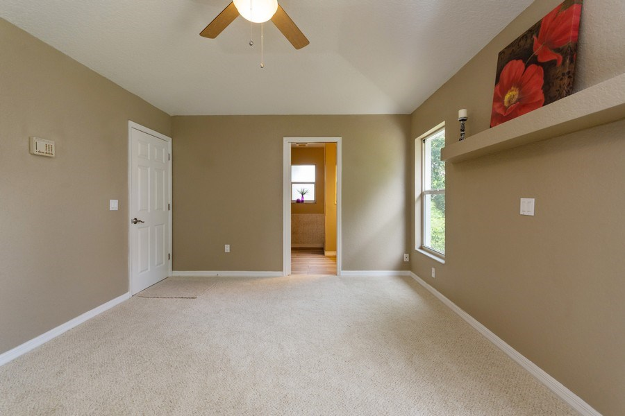 Real Estate Photography - 832 Parkwood Ave, Titusville, FL, 32796 - Master Bedroom