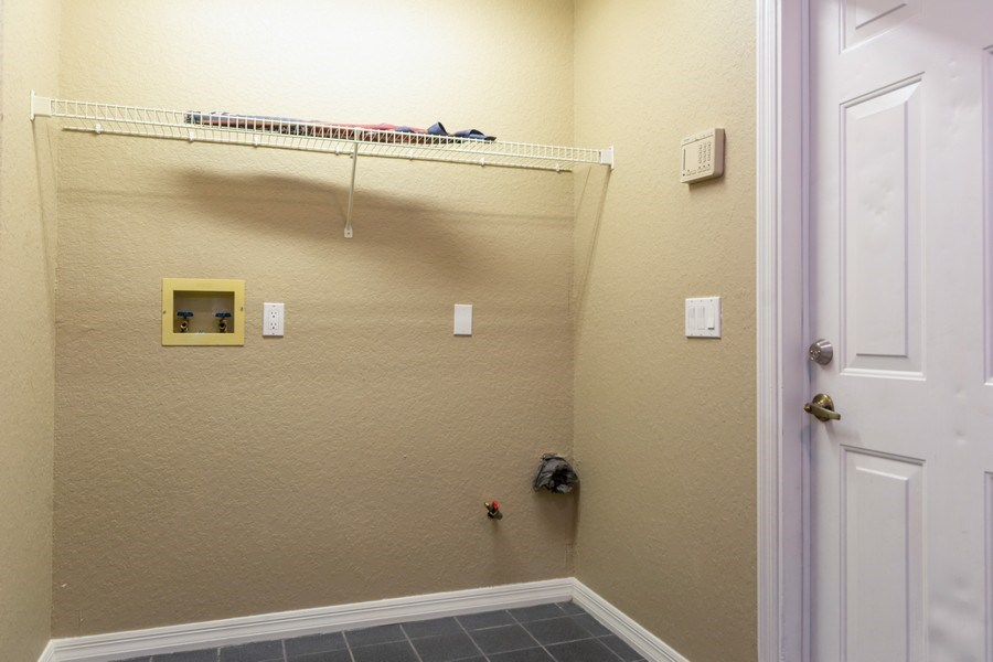 Real Estate Photography - 832 Parkwood Ave, Titusville, FL, 32796 - Laundry Room