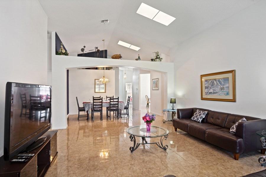 Real Estate Photography - 2508 Oneida Loop, Kissimmee, FL, 34747 - Living Room / Dining Room