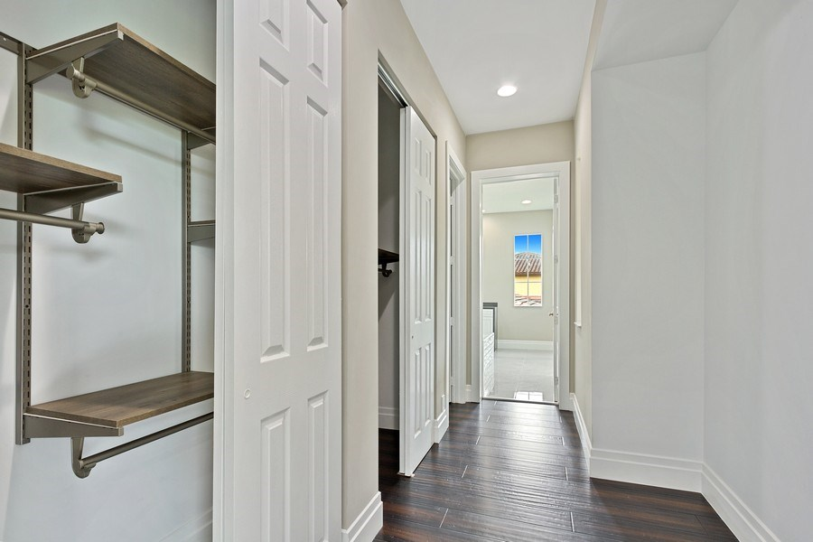 Real Estate Photography - 8146 NW 124th Ter, Parkland, FL, 33076 - Master Bedroom Closet
