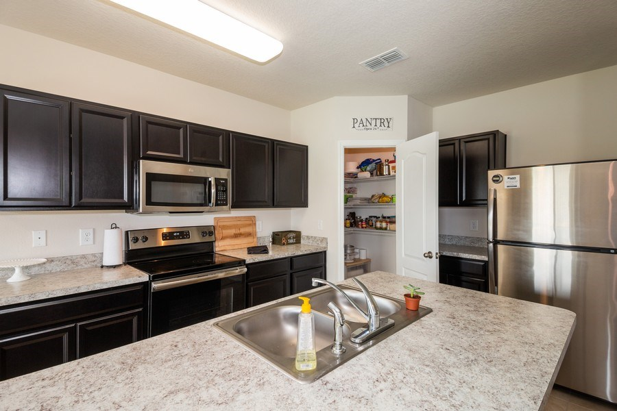 Real Estate Photography - 265 Tanager St, Haines City, FL, 33844 - Kitchen