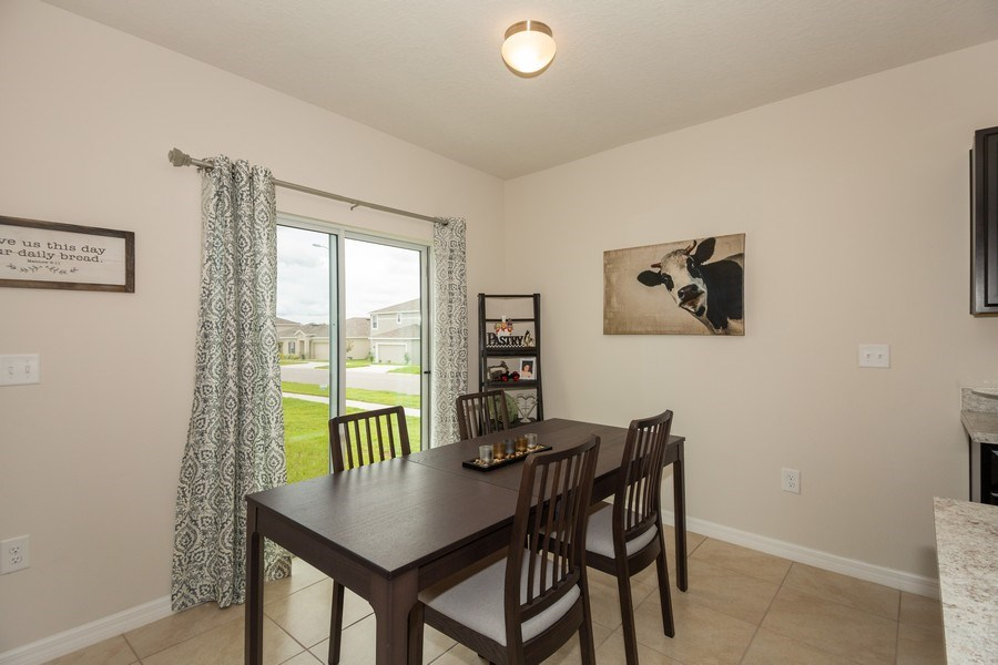Real Estate Photography - 265 Tanager St, Haines City, FL, 33844 - Dining Room