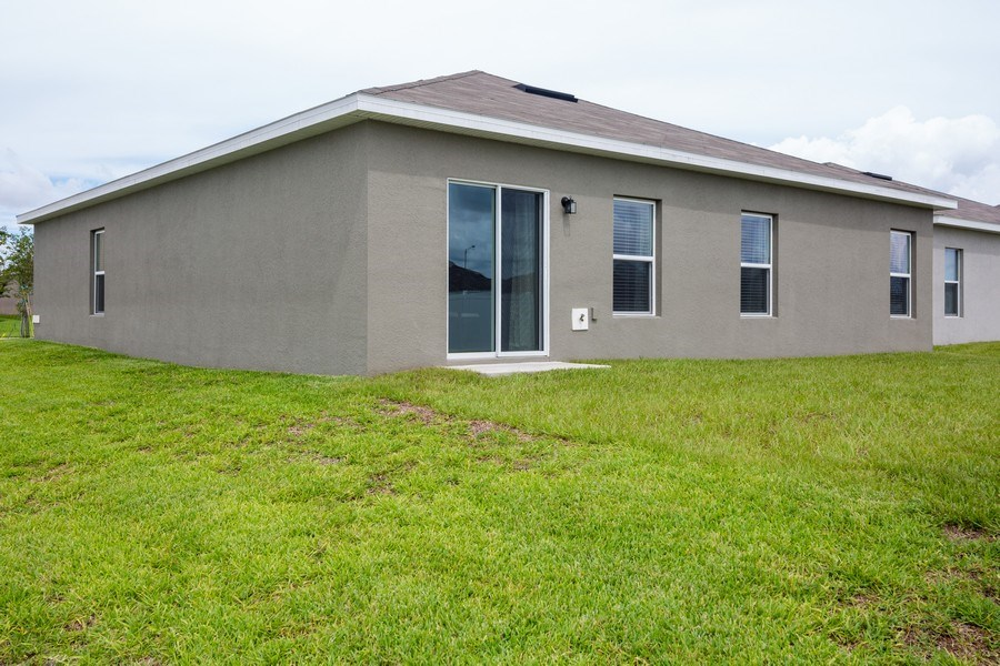 Real Estate Photography - 265 Tanager St, Haines City, FL, 33844 - Rear View