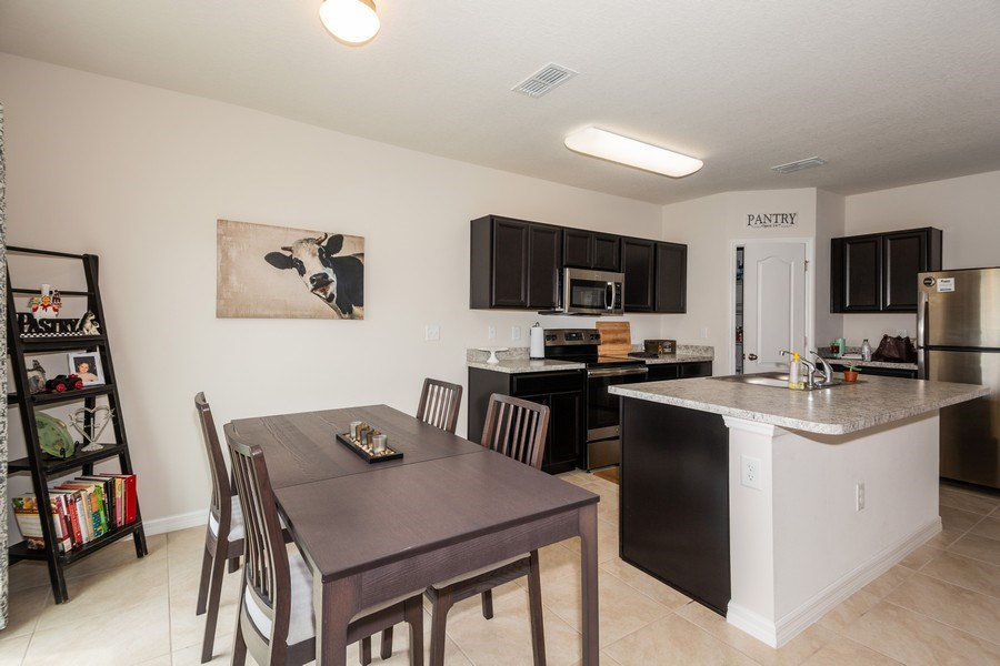 Real Estate Photography - 265 Tanager St, Haines City, FL, 33844 - Kitchen / Dining Room