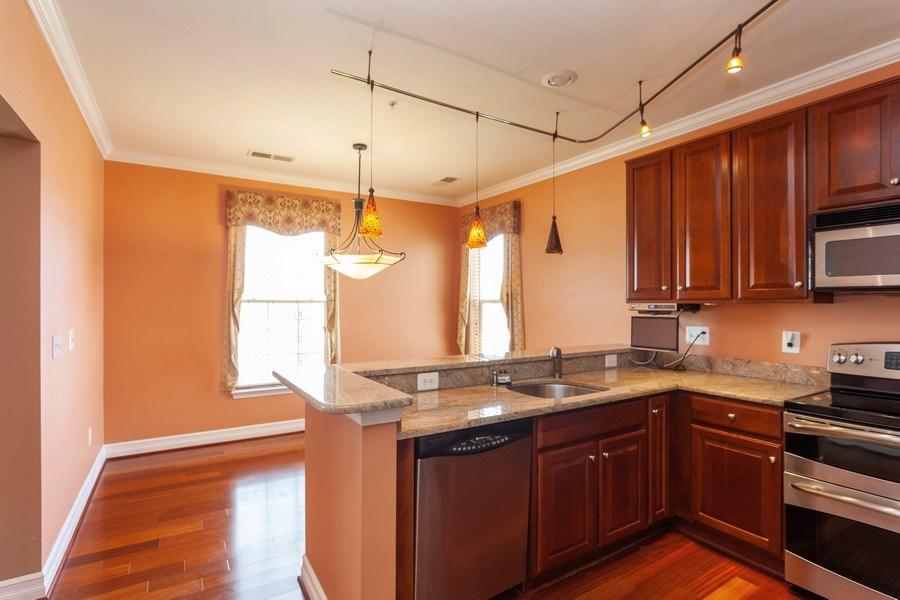 Real Estate Photography - 8608 Fluttering Leaf Trl, Unit 507, Odenton, MD, 21113 - Kitchen