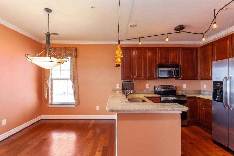 Real Estate Photography - 8608 Fluttering Leaf Trl, Unit 507, Odenton, MD, 21113 - Kitchen / Breakfast Room