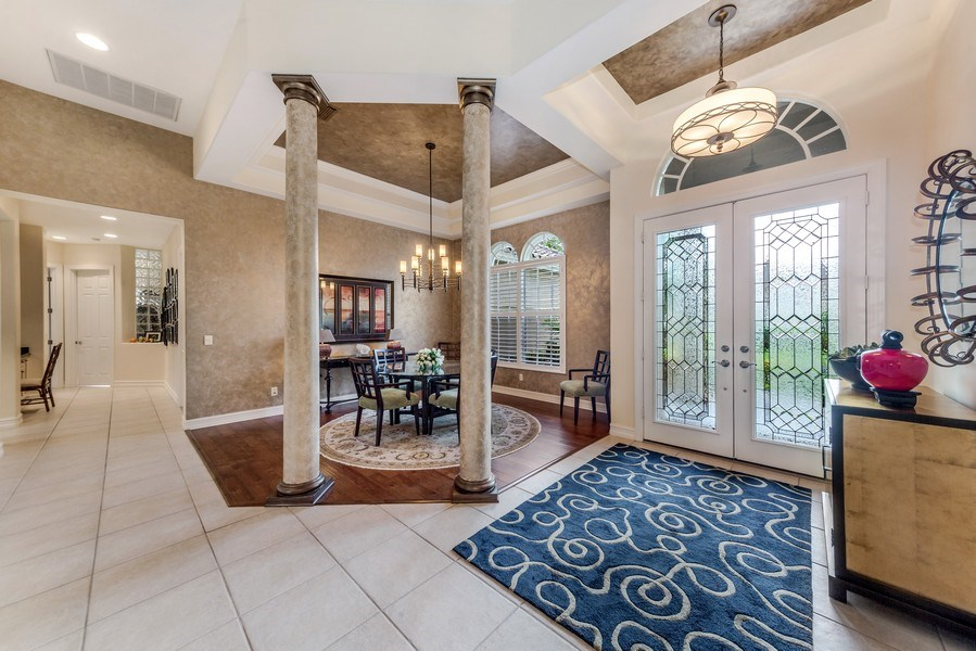 Real Estate Photography - 14560 Ocean Bluff Dr, Fort Myers, FL, 33908 - Foyer/Dining Room