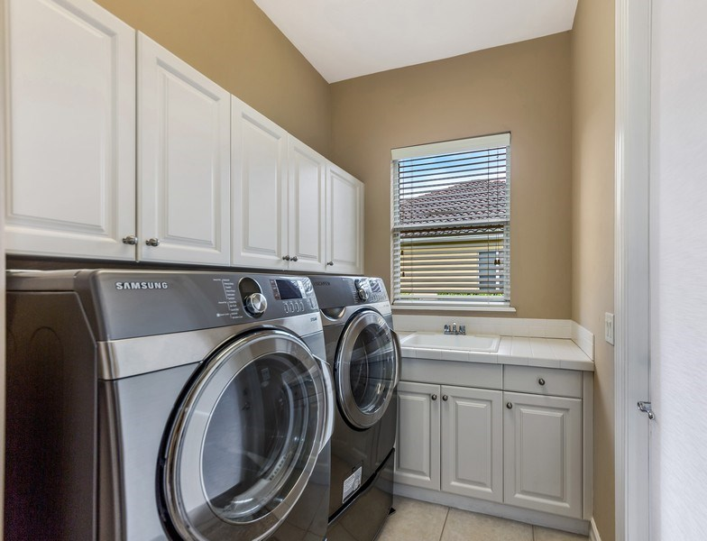 Real Estate Photography - 14560 Ocean Bluff Dr, Fort Myers, FL, 33908 - Laundry Room
