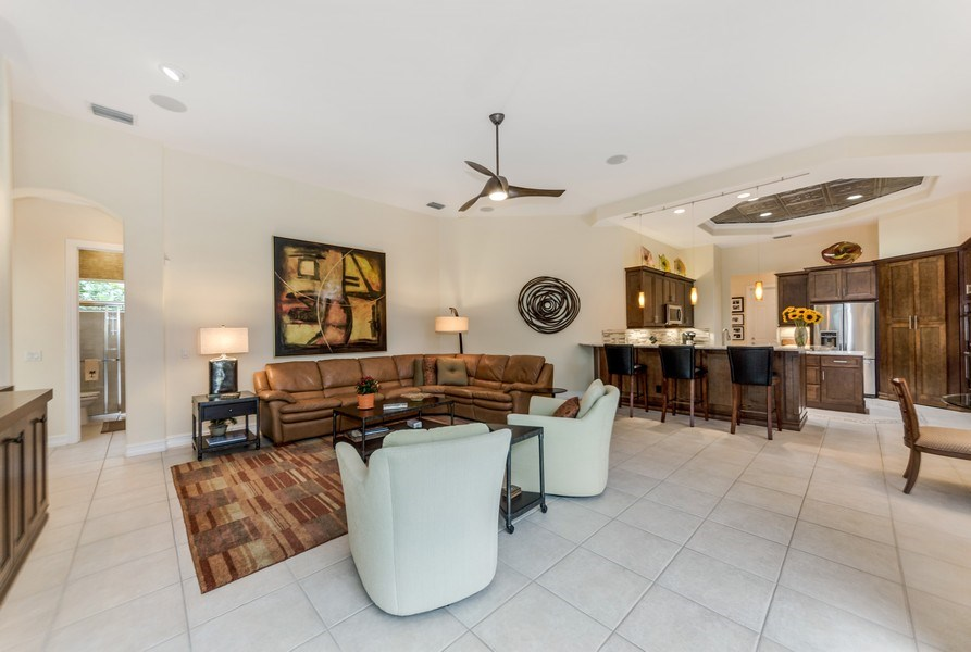 Real Estate Photography - 14560 Ocean Bluff Dr, Fort Myers, FL, 33908 - Family Room / Kitchen