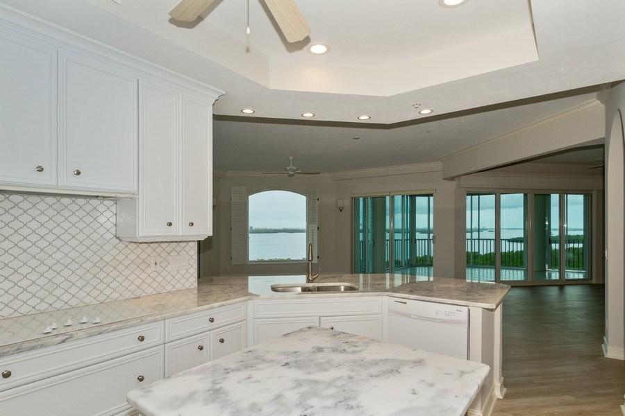 Real Estate Photography - 4811 ISLAND POND CT #704, Bonita Springs, FL, 34134 - Family Room / Kitchen