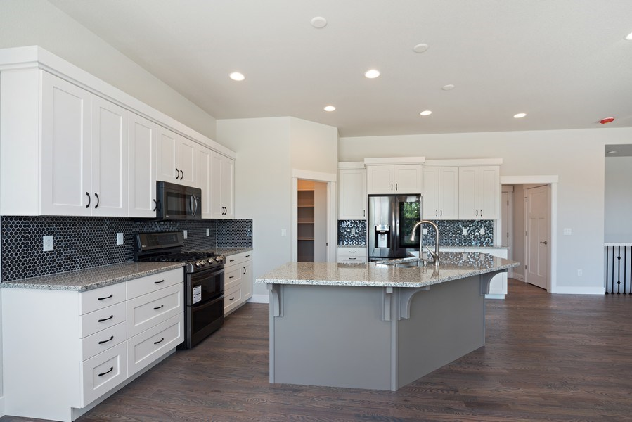 Real Estate Photography - 401 Cascade Ct, Johnstown, CO, 80534 - Kitchen