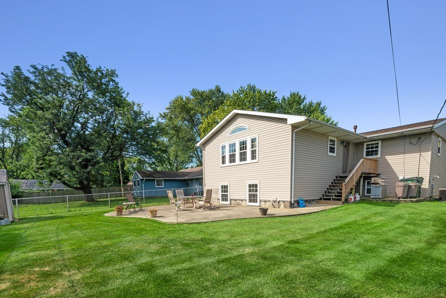 Real Estate Photography - 7819 Chestnut Ave, Woodridge, IL, 60517 - Rear View