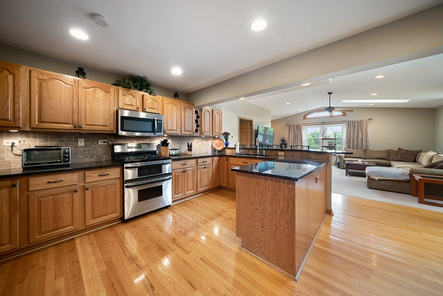 Real Estate Photography - 7819 Chestnut Ave, Woodridge, IL, 60517 - Family Room / Kitchen
