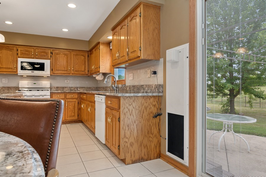 Real Estate Photography - 22W155 Glenrise Ct, Glen Ellyn, IL, 60137 - Kitchen with electronic pet door closed