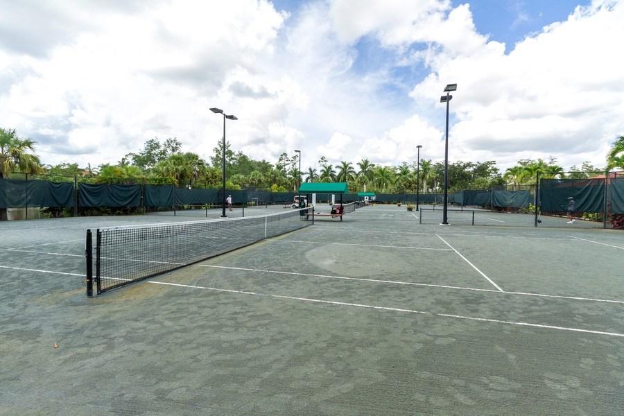 Real Estate Photography - 5075 Castlerock Way, Naples, FL, 34112 - Tennis Court