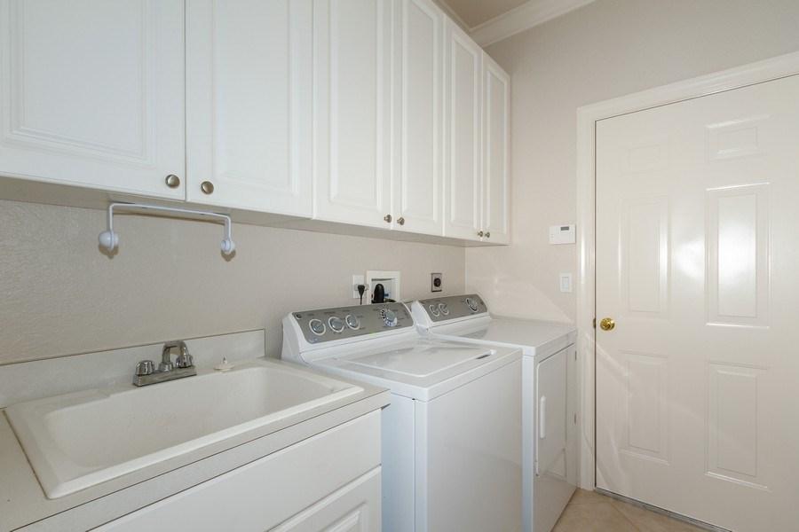 Real Estate Photography - 5075 Castlerock Way, Naples, FL, 34112 - Laundry Room