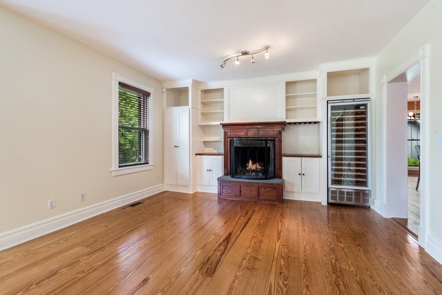 Real Estate Photography - 246 Main St, Cold Spring, NY, 10516 - Living room with fireplace and wine cooler