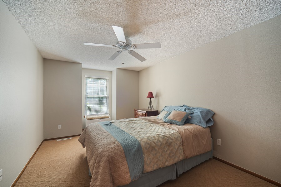 Real Estate Photography - 9989 Grove Way, Unit B, Westminster, CO, 80031 - 2nd Bedroom