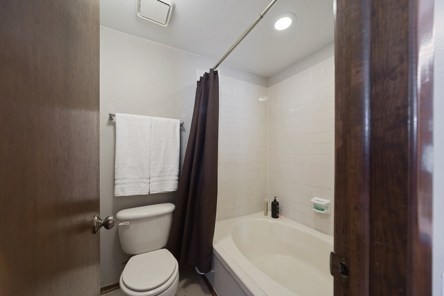 Real Estate Photography - 9989 Grove Way, Unit B, Westminster, CO, 80031 - Master Bathroom