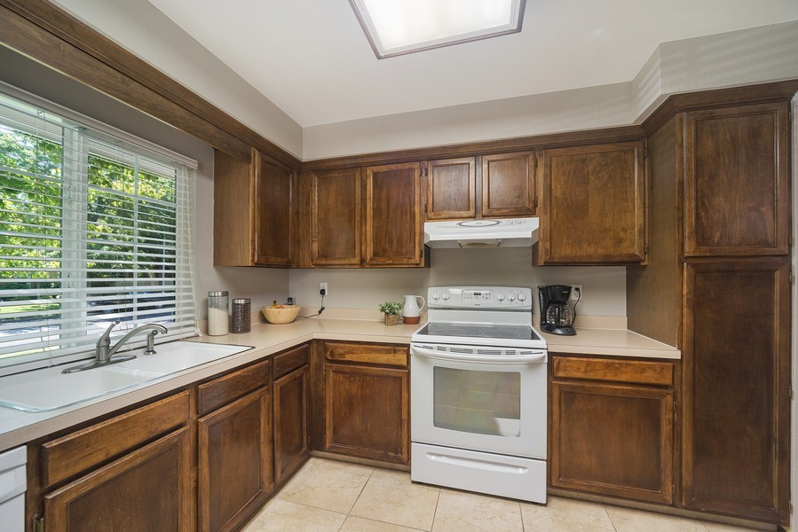 Real Estate Photography - 9989 Grove Way, Unit B, Westminster, CO, 80031 - Kitchen