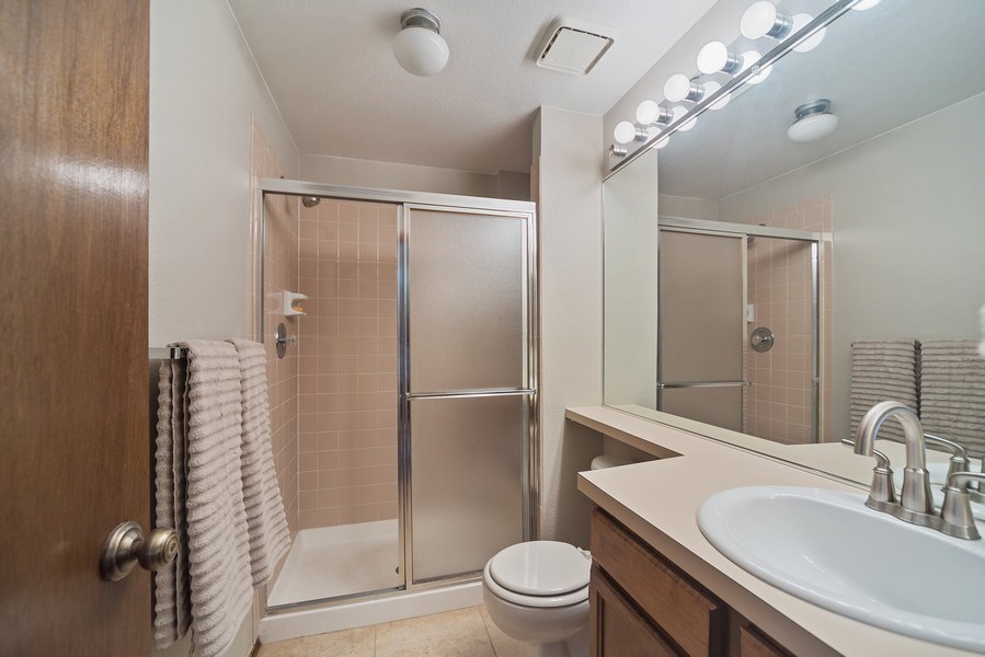 Real Estate Photography - 9989 Grove Way, Unit B, Westminster, CO, 80031 - 2nd Bathroom