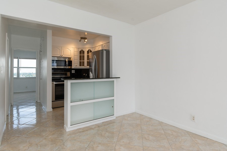 Real Estate Photography - 4050 N Ocean, Unit 1103, Lauderdale by the Sea, FL, 33308 - Dining Room