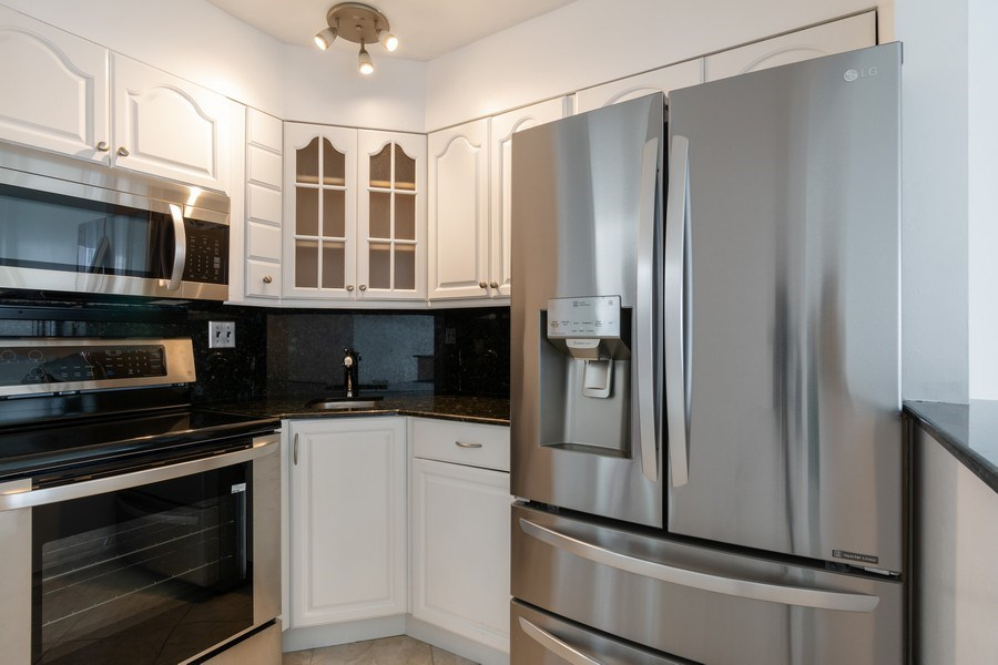 Real Estate Photography - 4050 N Ocean, Unit 1103, Lauderdale by the Sea, FL, 33308 - Kitchen