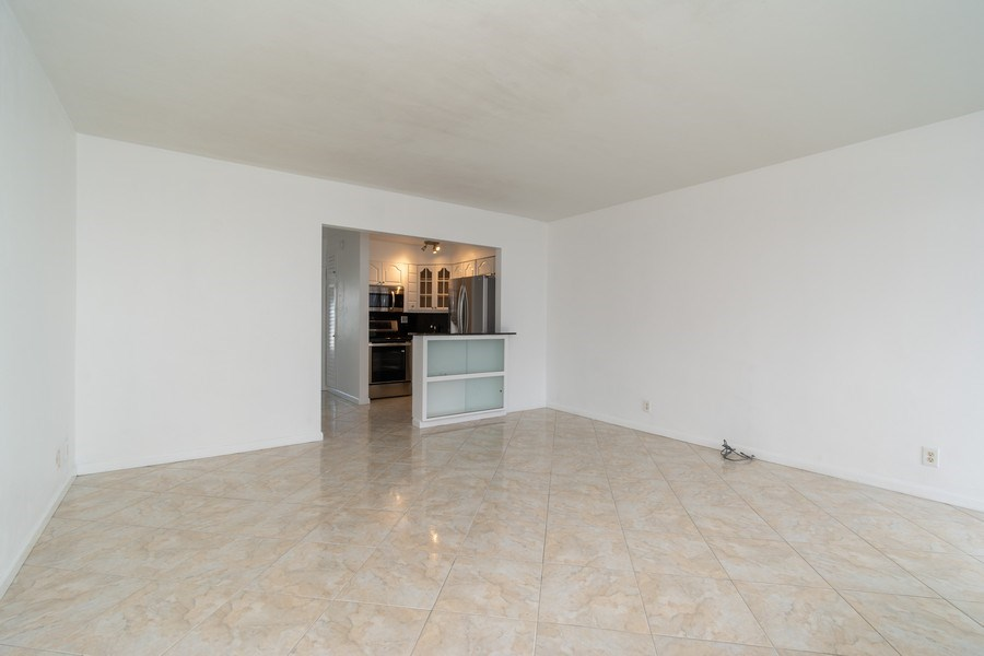 Real Estate Photography - 4050 N Ocean, Unit 1103, Lauderdale by the Sea, FL, 33308 - Kitchen / Living Room