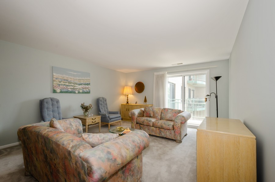 Real Estate Photography - 4757 W Howard, Unit 207, Skokie, IL, 60077 - Living Room