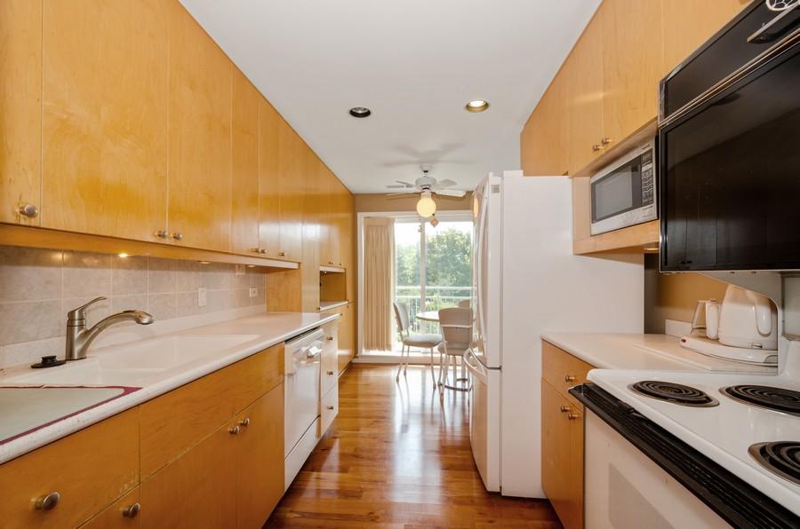 Real Estate Photography - 4757 W Howard, Unit 207, Skokie, IL, 60077 - Kitchen / Breakfast Room