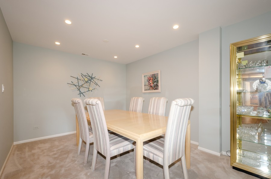 Real Estate Photography - 4757 W Howard, Unit 207, Skokie, IL, 60077 - Dining Room
