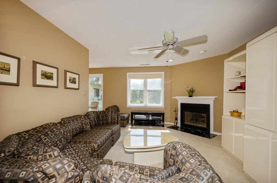 Real Estate Photography - 4757 W Howard, Unit 207, Skokie, IL, 60077 - Family Room