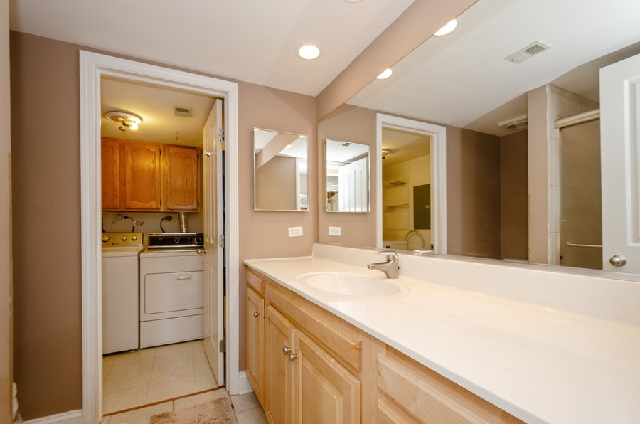 Real Estate Photography - 4757 W Howard, Unit 207, Skokie, IL, 60077 - Laundry Room
