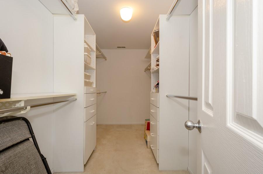 Real Estate Photography - 4757 W Howard, Unit 207, Skokie, IL, 60077 - Master Bedroom Closet