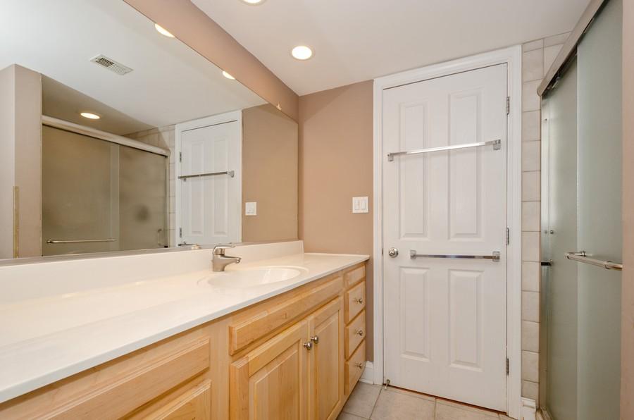 Real Estate Photography - 4757 W Howard, Unit 207, Skokie, IL, 60077 - 2nd Bathroom