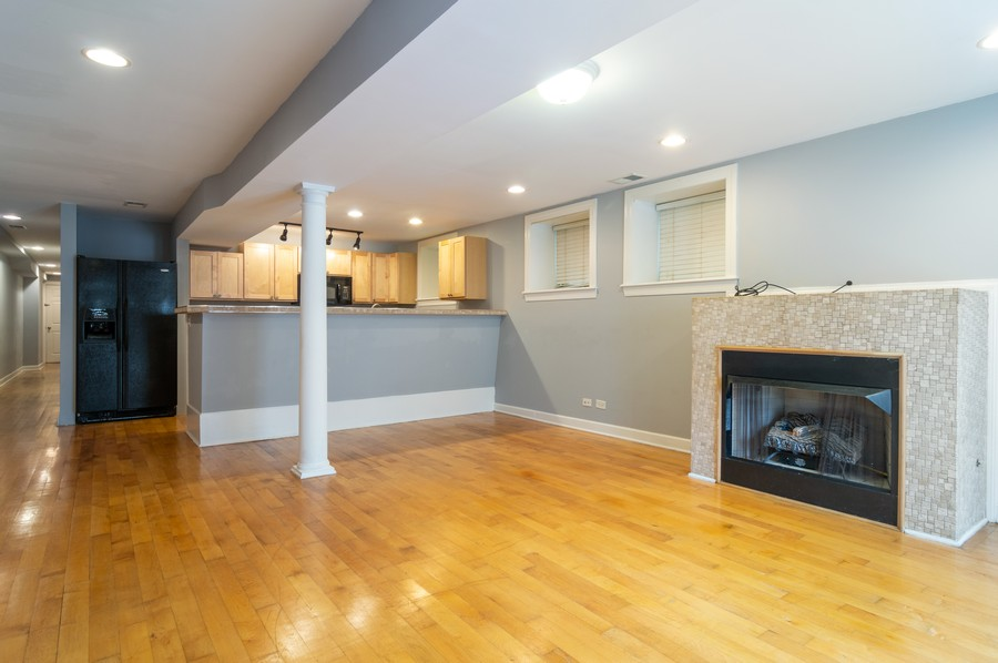 Real Estate Photography - 2443 W Harrison, unit A, Chicago, IL, 60612 - Kitchen / Living Room
