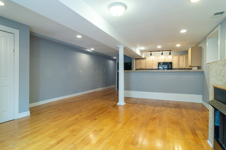 Real Estate Photography - 2443 W Harrison, unit A, Chicago, IL, 60612 - Living Room / Dining Room