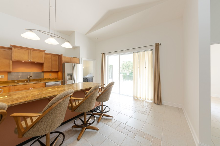 Real Estate Photography - 11144 Waterford Ave, Englewood, FL, 34224 - Kitchen/Dining