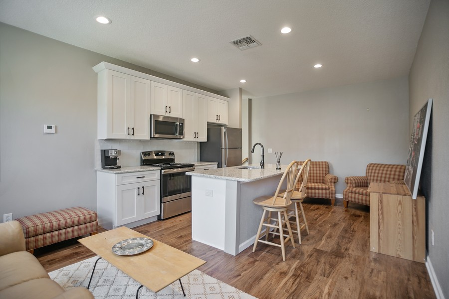 Real Estate Photography - 1103 Mosaic Drive, Celebration, FL, 34747 - Apartment Kitchen/Living Area 2