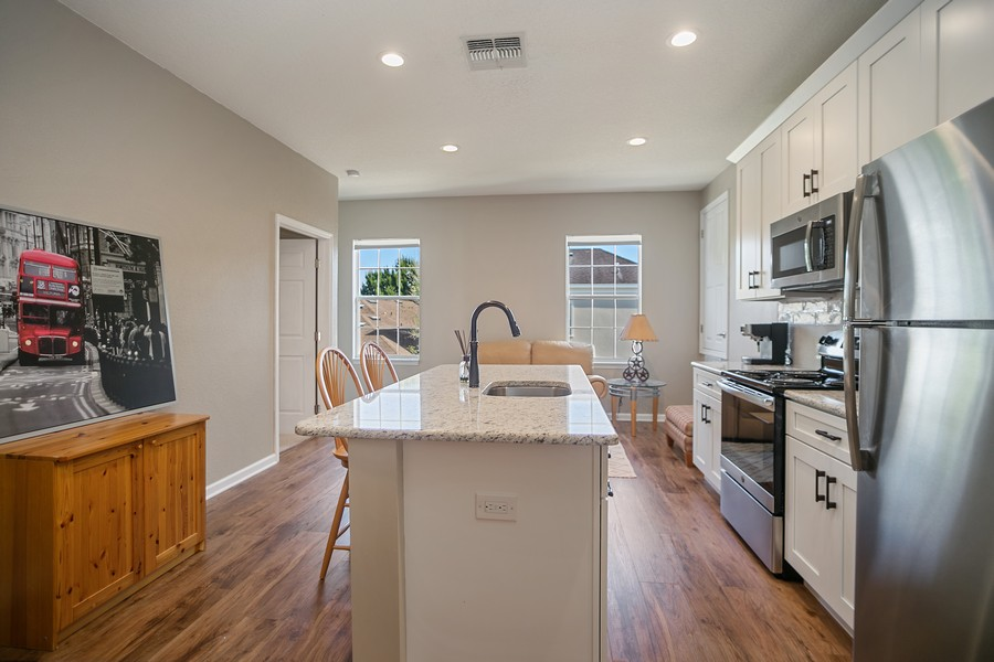 Real Estate Photography - 1103 Mosaic Drive, Celebration, FL, 34747 - Apartment Kitchen/Living Area