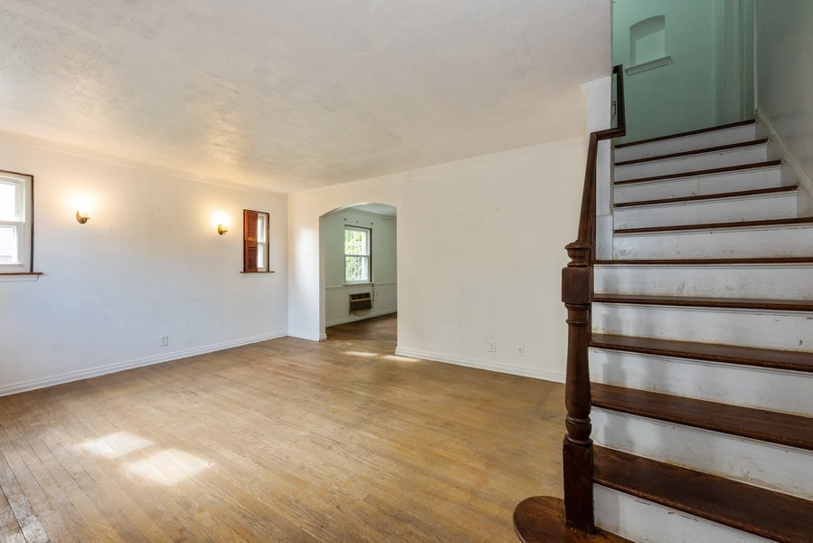 Real Estate Photography - 80-42 208th St, Queens Village, NY, 11427 - Living Room - View Up Stairs