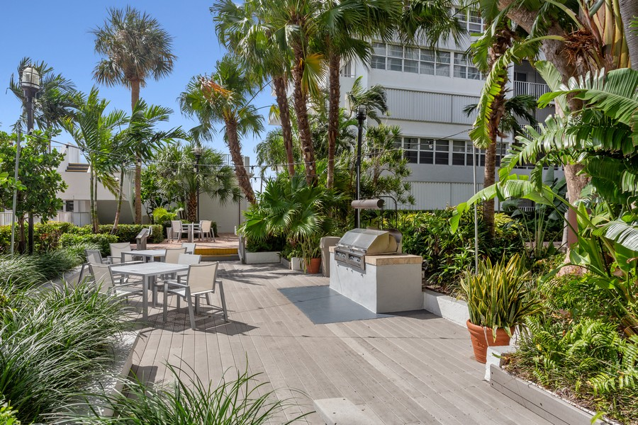 Real Estate Photography - 1170 N FEDERAL HWY, #509, FT LAUDERDALE, FL, 33304 - BBQ PATIO AREA